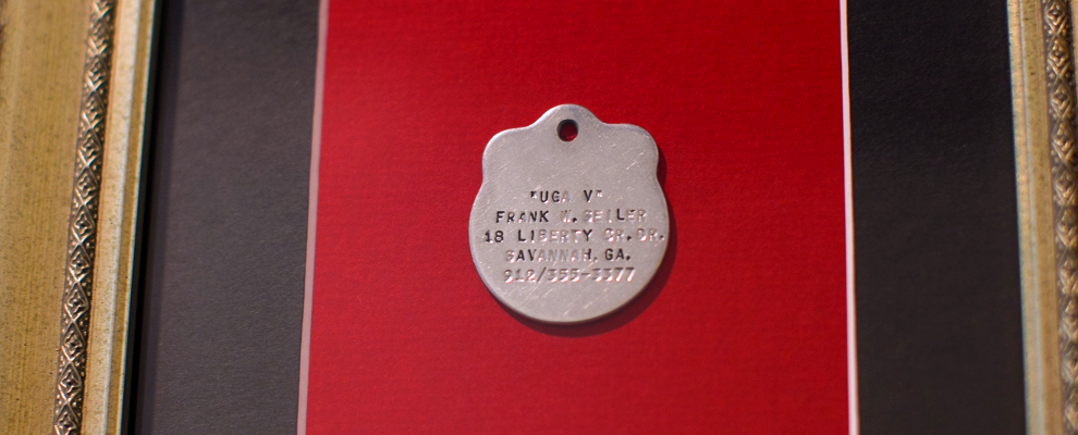 Uga V's dog tag displayed at the Uga Suite