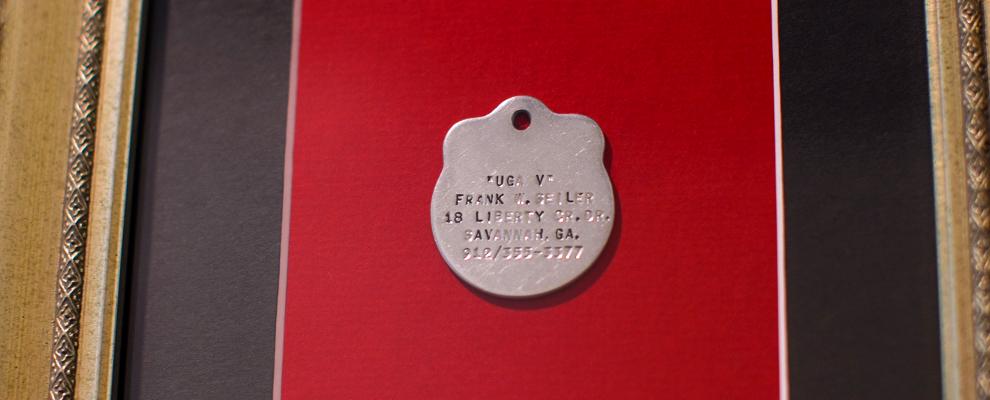 Uga V's dog tag displayed at the Uga Suite
