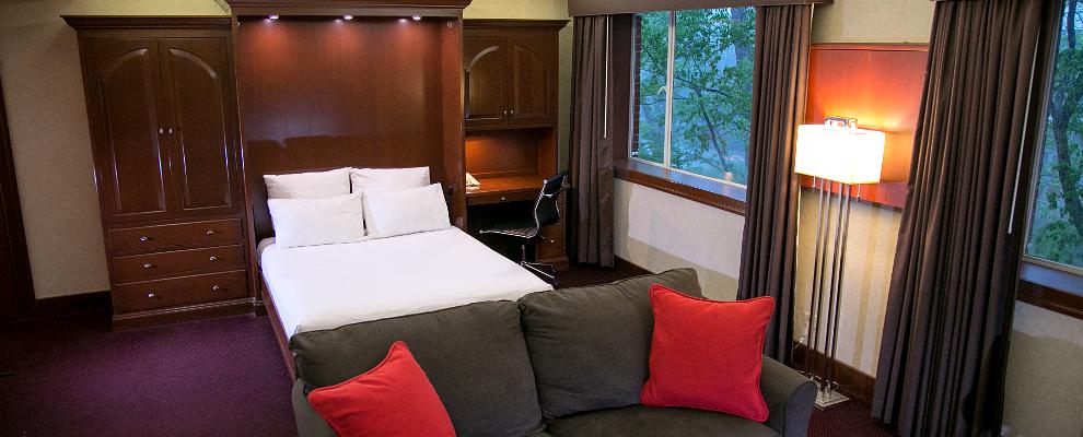 Plaza Queen Suite bedroom at UGA Hotel